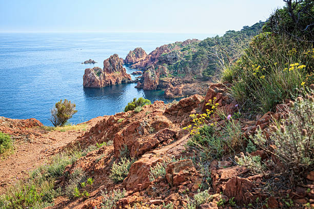 Stone Formations at the peninsula Cap du Dramont near Frejus. The Cap du Dramont lies at the scenic coast road Corniche d'Or between Cannes and Frejus at the French Riviera below the Massif d'Esterel. It has the same red porphyry stones as the Massif d'Esterel.